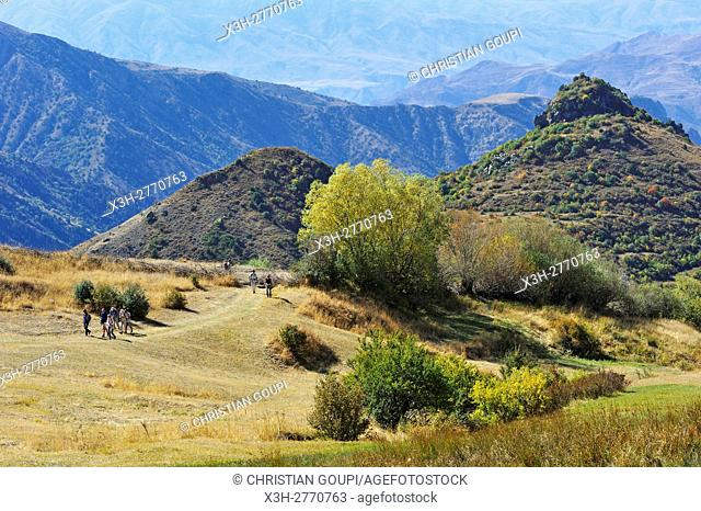 hikers on the access path to Tsakhats Kar Monastery, near Yeghegnadzor, Vayots Dzor province, Armenia, Eurasia