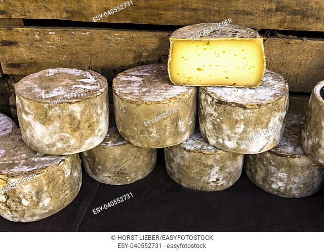Stacked cheese loaves at the market of St Remy de Provence, Buches du Rhone, Provence, France