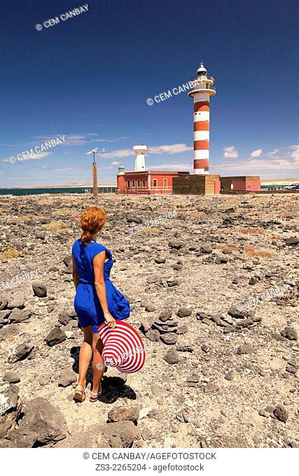 Woman near the Faro de Toston lighthouse, El Cotillo, Fuerteventura, Canary islands, Spain, Europe