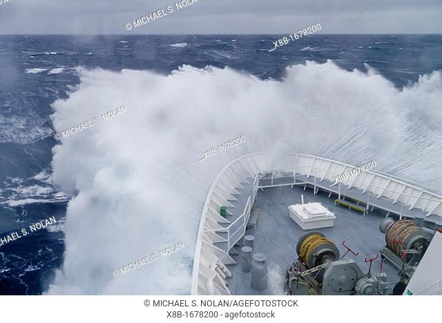 The Lindblad Expeditions ship National Geographic Explorer in a Beaufort Scale 10 storm 35 foot seas and 50+ knot winds in the Drake Passage between the...