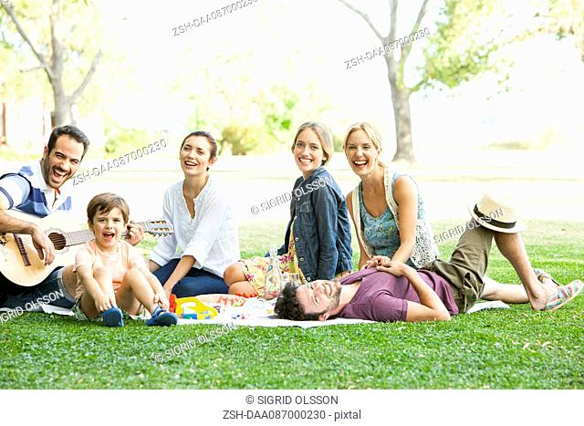 Friends relaxing together in the park