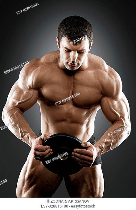 Portrait of bodybuilder with dumbbells