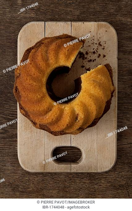Gugelhupf cake or bundt cake with crumbs