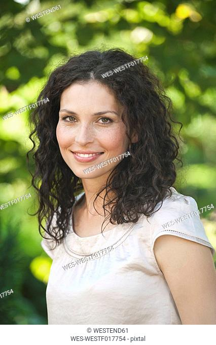 Germany, Bavaria, Mid adult woman smiling, portrait