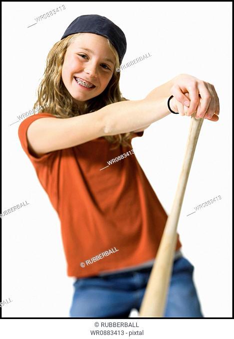 Portrait of a girl holding a baseball bat