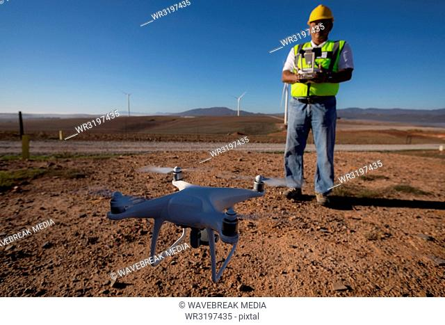 Engineer controlling a drone with a controller
