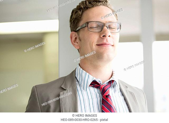 mis-adult businessman reflecting with eyes closed