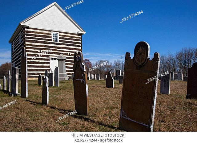 Schellsburg, Pennsylvania - The Old Log Church, built in 1806. The first burial in the cemetery was in the same year. Originally the church had no heat;...