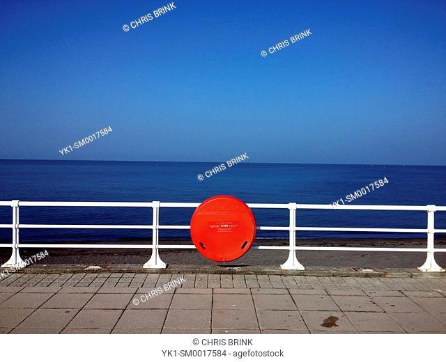 Lifebuoy on the promenade in Aberystwyth Wales UK