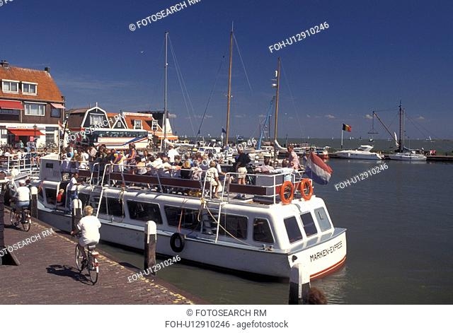 Netherlands, Volendam, Holland, Noord-Holland, Europe, Excursion boat at the waterfront on the harbor on Markermeer in the town of Volendam