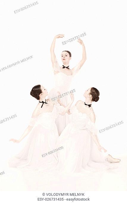 Romantic Beauty. The portrait of a three women as ballerinas in retro style
