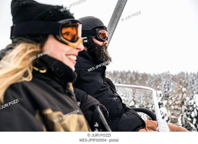 Italy, Modena, Cimone, couple in a ski lift