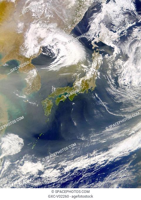 Dust continued to fill the skies over eastern Asia yesterday. The full-resolution version of this image also shows that the volcano, Mount Oyama