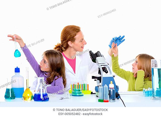 children girls and teacher woman at laboratory on school chemical class