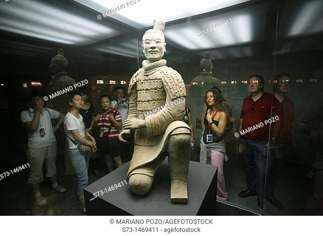 People looking at terracotta warrior. Xian City. Shaanxi Province. China