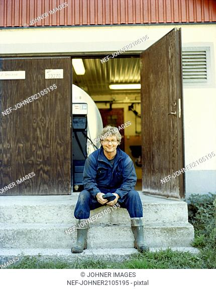 Farmer sitting on stairs