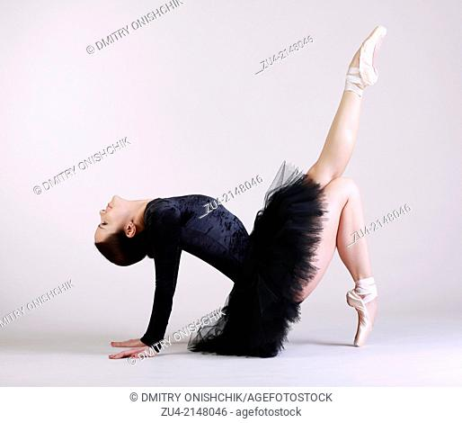 Ballerina posing in black tutu