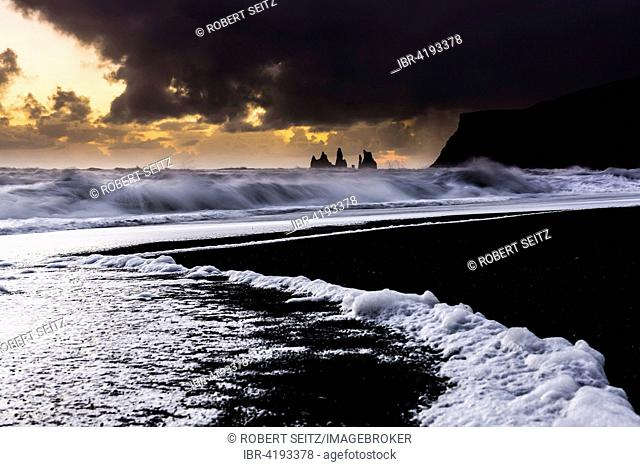Beach, Reynisdrangar at sunset with ocean surf, black sand, in Vik, Southern Region, Iceland