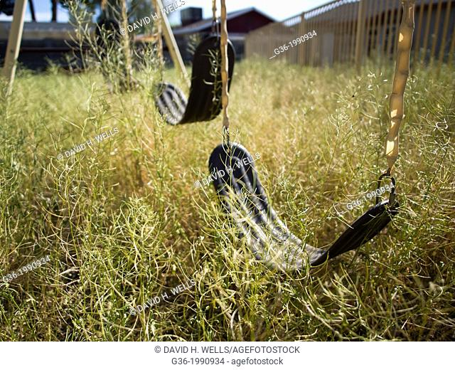 Empty swings outside a foreclosed house in Mesa, Arizona, United States