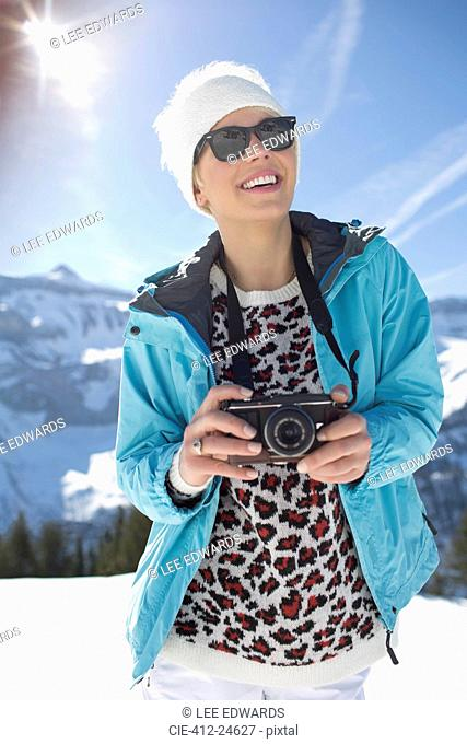 Woman with camera in snow