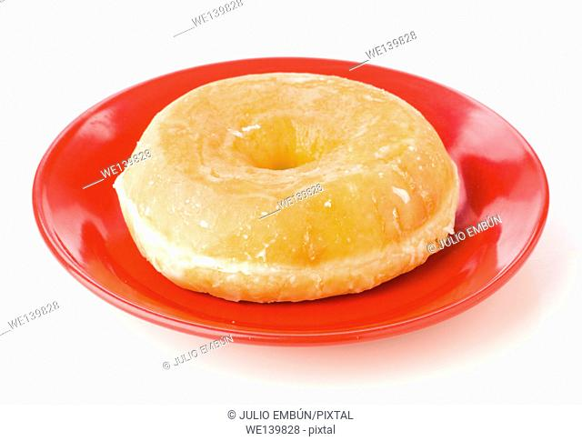 donut on red dish isolated on white