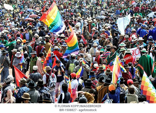 Crowd with Wiphala, rainbow-colored flag of the highland Indians, at the re-election ceremony for President Evo Morales Ayma in Tiwanaku, La Paz, Bolivia