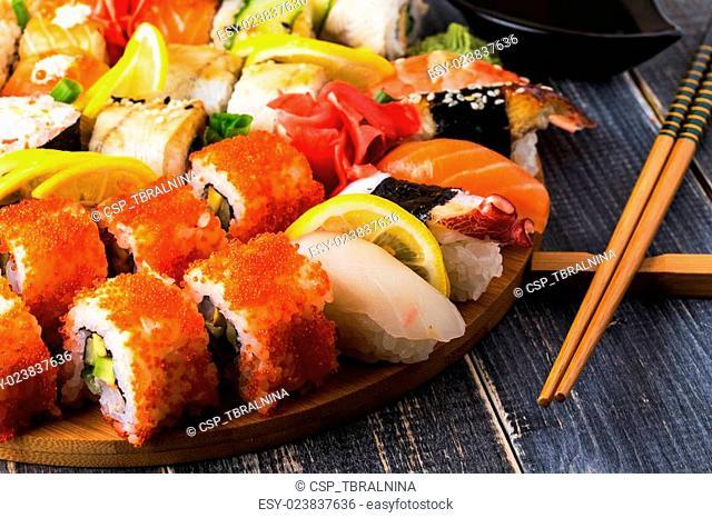 Sushi Set: sushi and sushi rolls on wooden plate