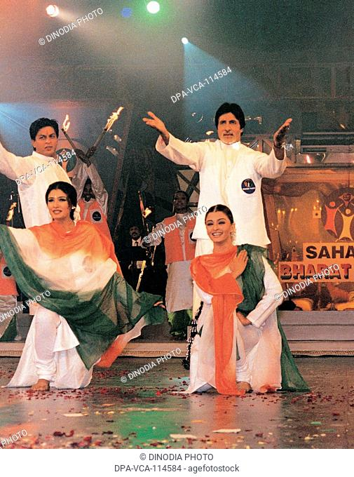 South Asian Indian actors Shahrukh Khan , Aishwarya Rai , Raveena Tandon and Amitabh Bachchan at a sahara function in Lucknow , India NO MR