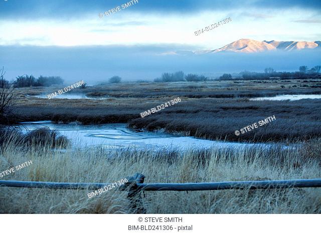 River in foggy mountain landscape