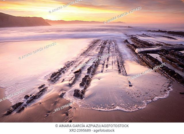 Sunset and Flysch in Iturun beach, Zumaia, Gipuzkoa, Basque Country