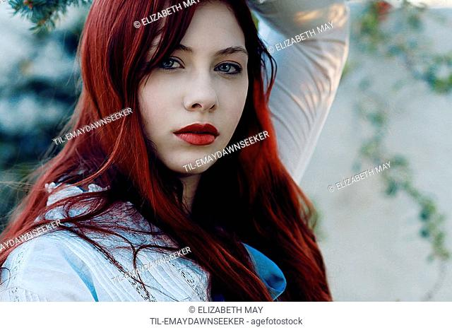 A close up of a girl with red hair