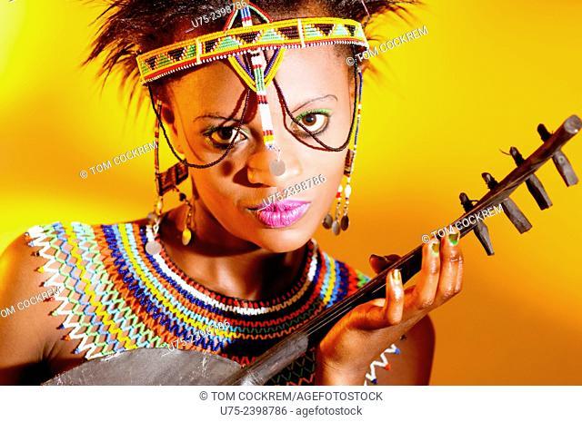 Young Kenyan woman in tribal costume in studio setting