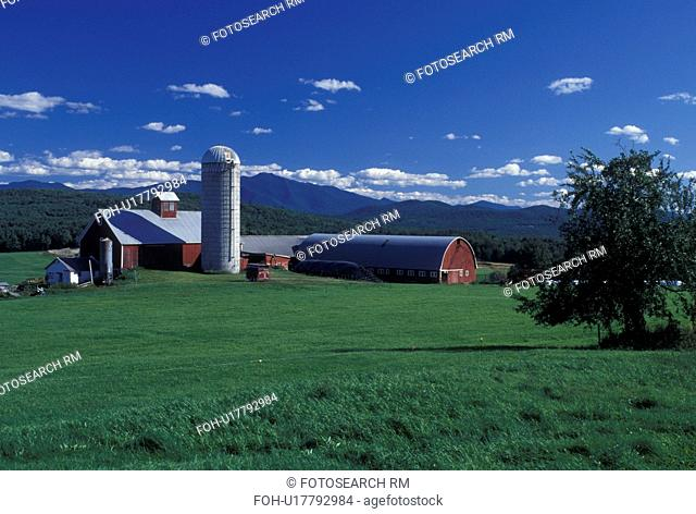Vermont, VT, Red barn at Tinker Farm and view of Mt. Mansfield in Fletcher