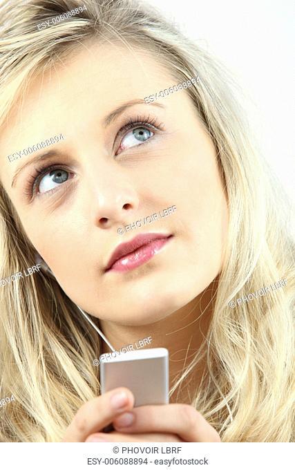 Dreamy girl listening to music
