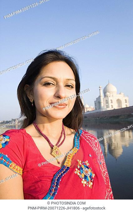 Portrait of a woman with a mausoleum in the background, Taj Mahal, Agra, Uttar Pradesh, India