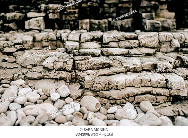 Pebbles, uneven layers of stone and rocks