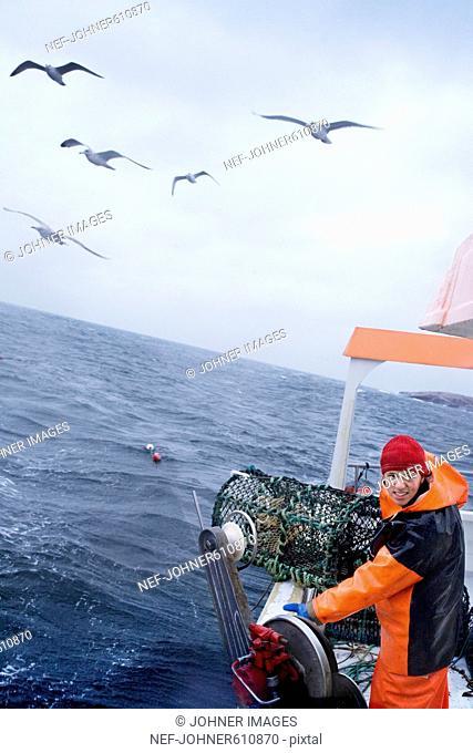 Fishermen on a boat, Sweden