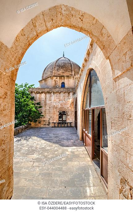 Gate and courtyard of Hamidiye Mosque(Seyh Zebuni)built in 1347 and locates in Mardin,Turkey. 17 June 2018