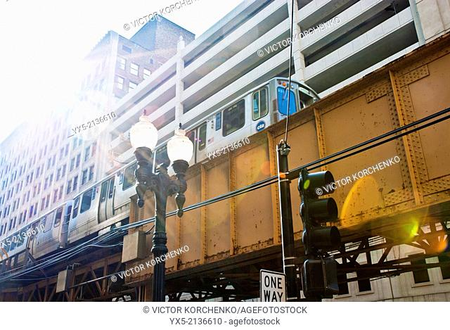 Loop train riding above a street in Chicago