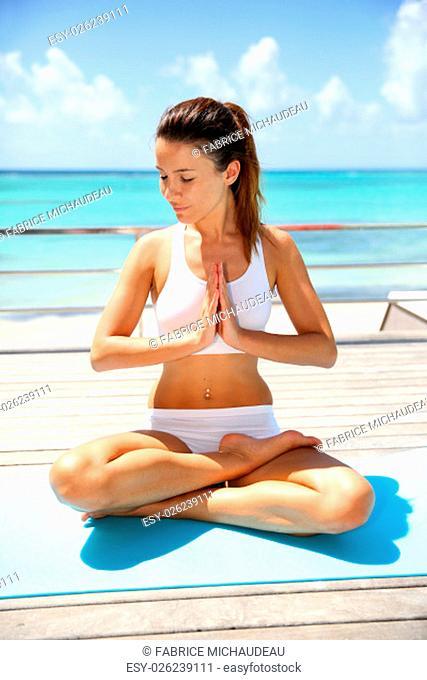 Beautiful brunette girl in lotus position
