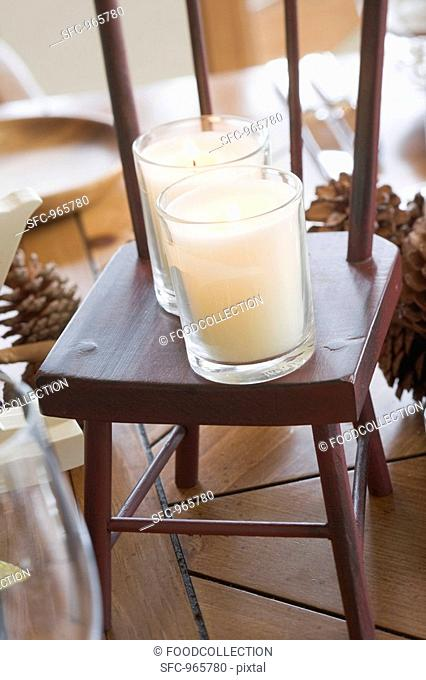 Christmas table decoration: candles on small chair