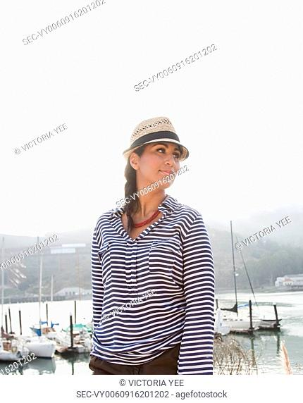 Portrait of young woman in harbor