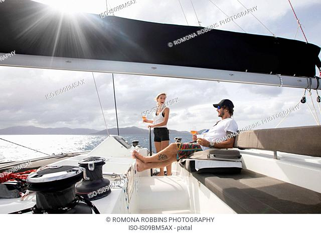 Man and woman sailing, British Virgin Islands