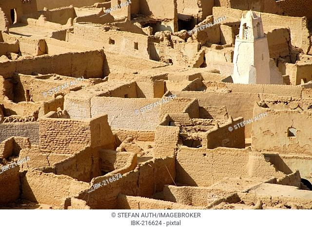 Old walls made of clay with minaret old city Ghat Fezzan Libya