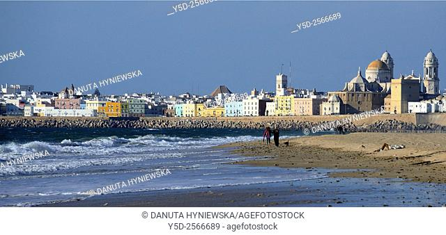 Panoramic view for old town with Cathedral, breakwater and beach, Cadiz, Costa de la Luz, Andalusia, Spain