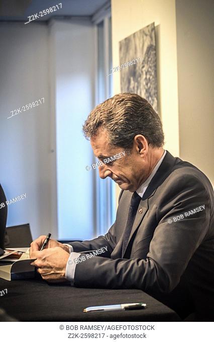 Nicolas Sarkozy signing his book ' France for life'