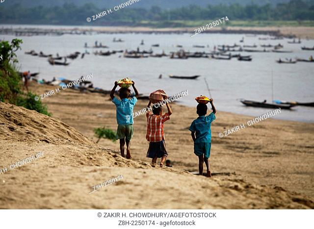 Children are going to working place of their father carrying lunch box, Bangladesh