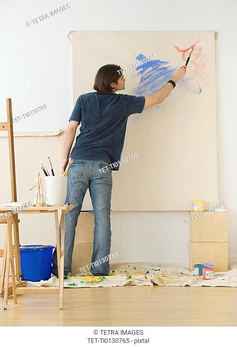 Man painting on easel
