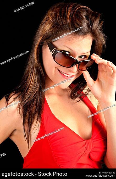 Beautiful Girl Looking Over Sunglasses