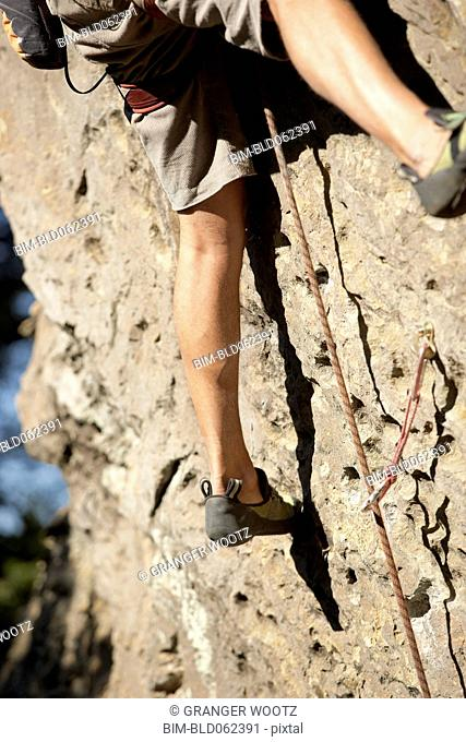 Close up of Argentinean man rock climbing